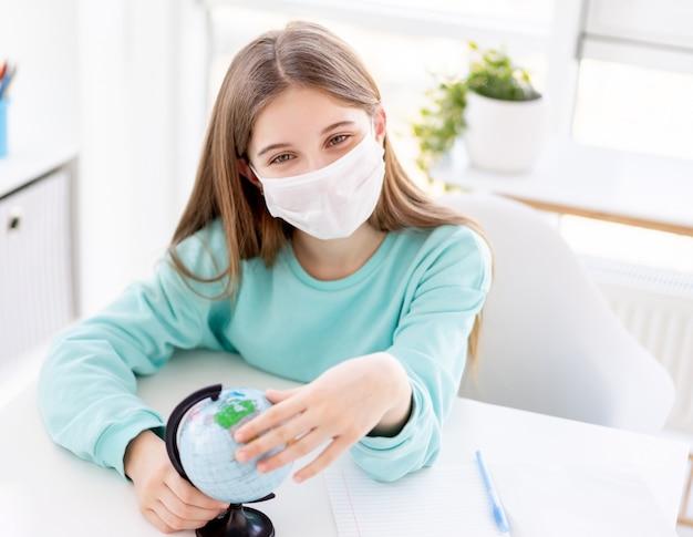 Optimistic girl in medical mask