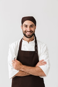 Optimistic young sous-chef posing in uniform.