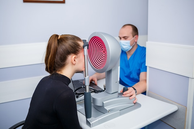An optometrist at his clinic studies vision. ophthalmology, medical diagnostics.
