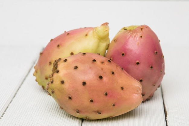 Opuntia ficus-indica cactus fruits on a white background