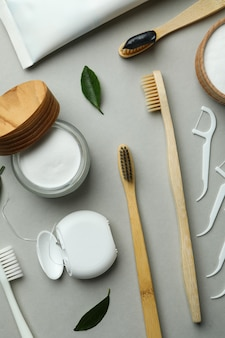 Oral care accessories on gray background