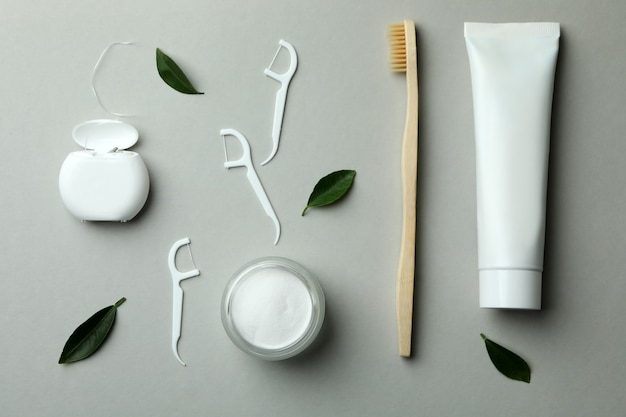 Oral care accessories on gray, top view