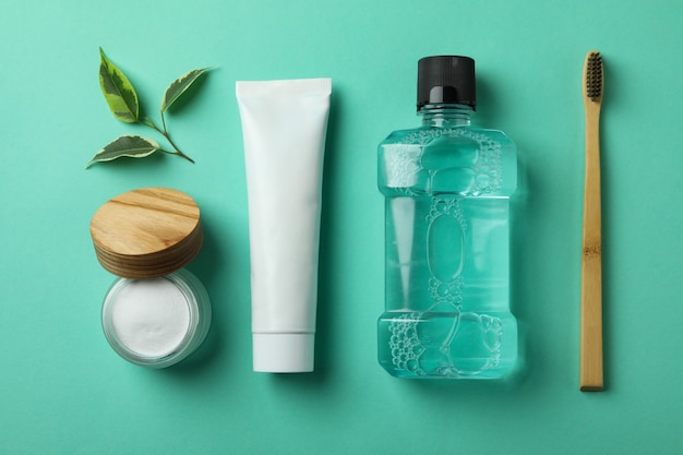 Oral care accessories on mint background