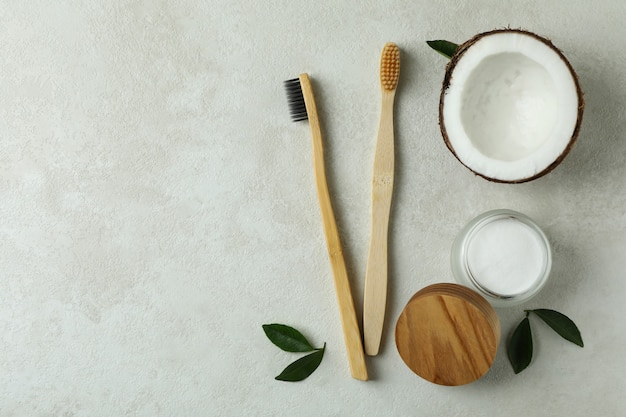 Oral care accessories on white textured background