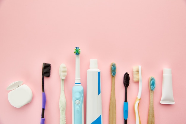 Oral care products. morning healthcare procedures concept, toothcare, different toothbrushes and toothpaste, brush and cream in bottle