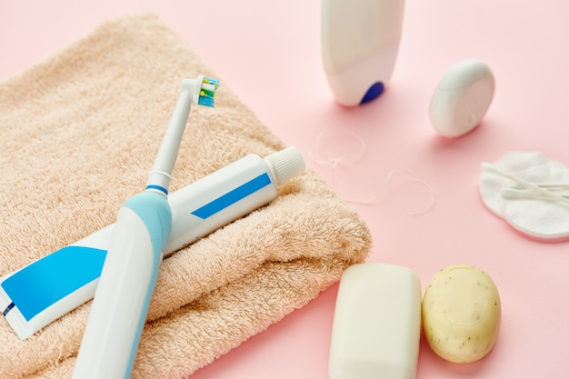 Oral care products, toothbrush, toothpaste and dental floss on towel. morning healthcare procedures concept
