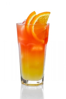 Orange alcohol cocktail with fruit slices isolated on white