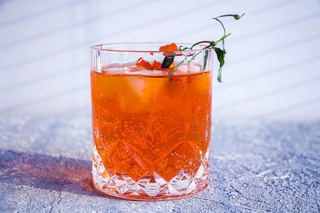 Orange alcoholic cocktail with whiskey, liqueur and orange peel