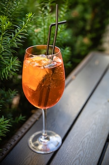 Orange alcoholic drink in glasses with ice