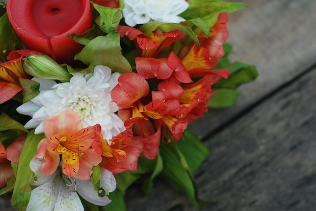 Orange alstromeria flower arrangement over wooden.