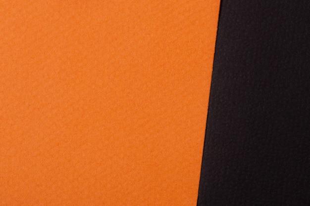 オレンジと黒の紙の背景