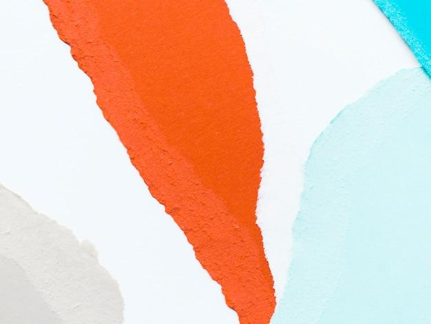 オレンジと青の破れた紙