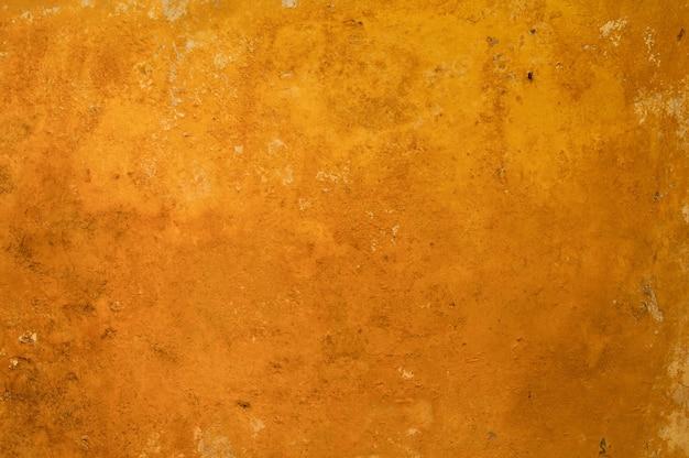 오래되고 녹슨 금속 형태의 주황색과 구리색 배경
