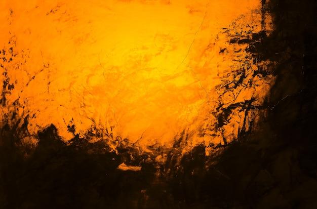 Оранжевый и темный фон кирпичной стены