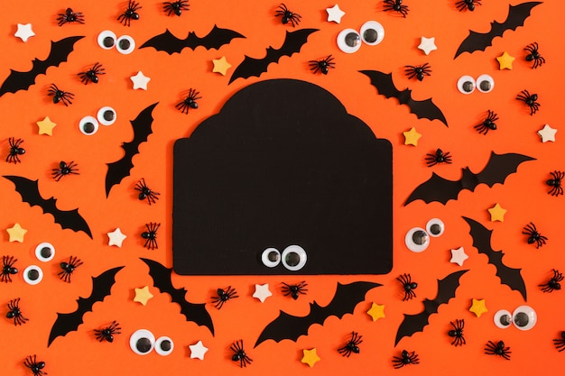 On orange background are lined with many decorative bats, asterisks and puppet eyes.