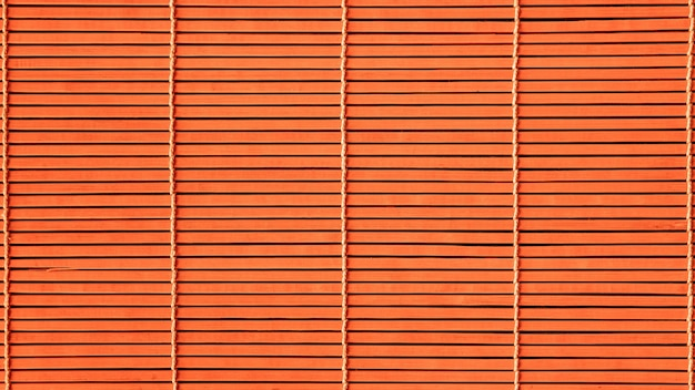 Orange background of the wooden mats.