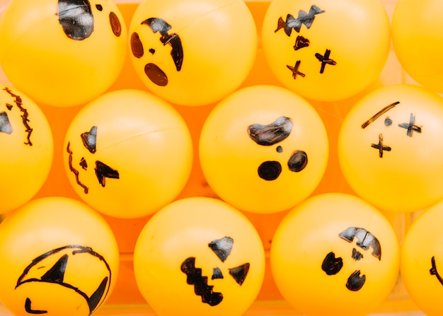 Orange balls with painted spooky faces
