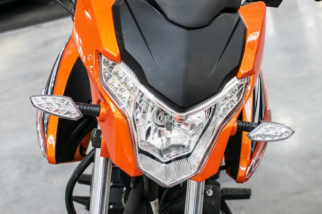 Orange bike, motorcycle, moped with lights