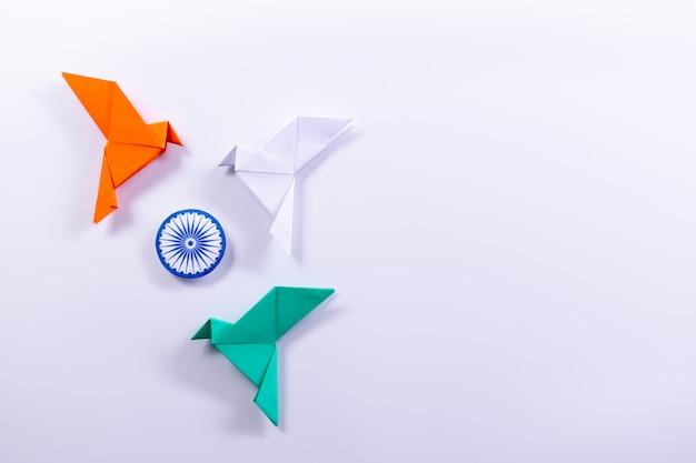 Orange bird,  white bird, blue bird with ashoka chakra