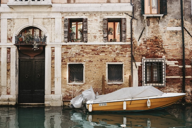 Orange boat in front of building