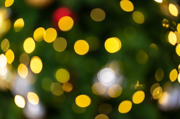 Orange bokeh on green of christmas tree