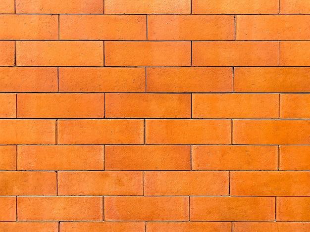 Оранжевая кирпичная стена как фон