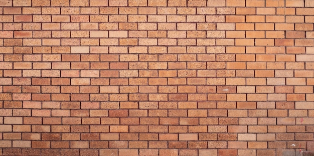 Оранжевый фон кирпичной стены.