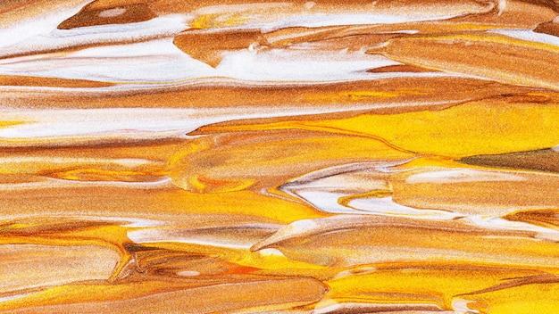 キラキラとオレンジブラウンの背景。抽象的なペイントテクスチャ。ゴールドペイントのクリエイティブなブラシストローク
