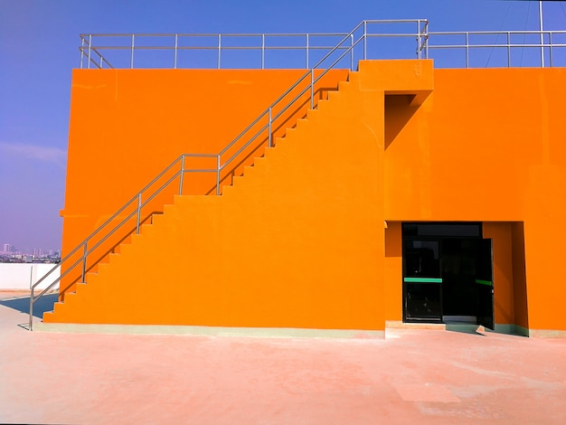 Orange building walls and buildings and sky