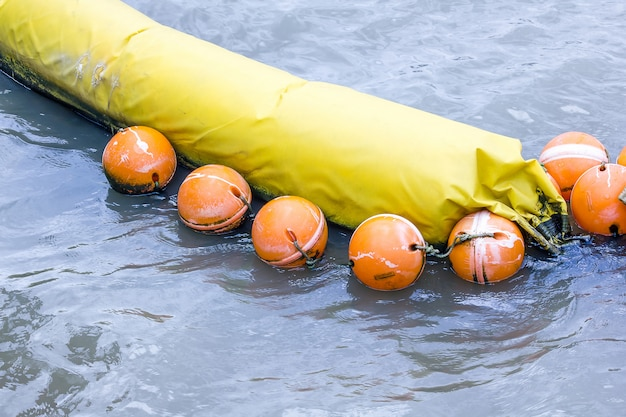 Orange buoy used in the form of water made from special plastic that is strong and durable