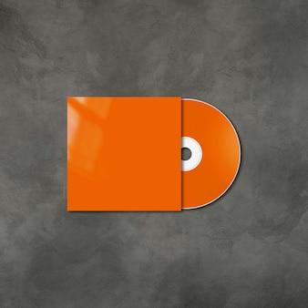 Оранжевый cd - dvd этикетка и шаблон макета обложки, изолированные на бетонном фоне