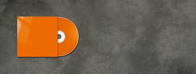 Orange cd label and cover on horizontal concrete banner