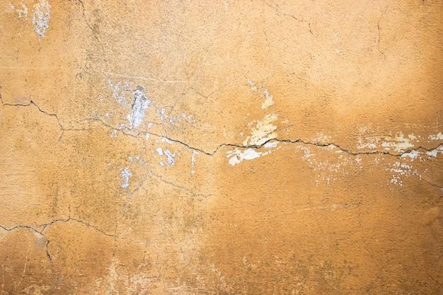디자인을 위한 배경으로 주황색 시멘트 벽 콘크리트 질감 클로즈업