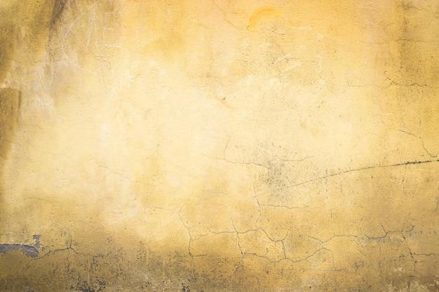 デザインの背景としてオレンジ色のセメント壁コンクリートテクスチャのクローズアップ