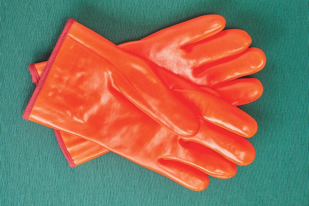 Orange chemical resistant gloves with protection from cold, industrial protective clothing.