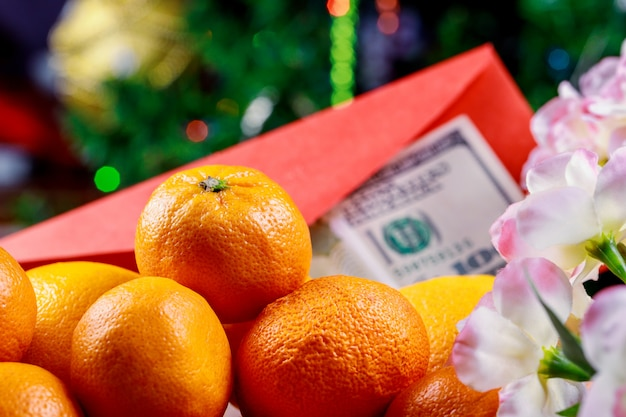 Orange for chinese new year. holiday concept and u.s. dollars