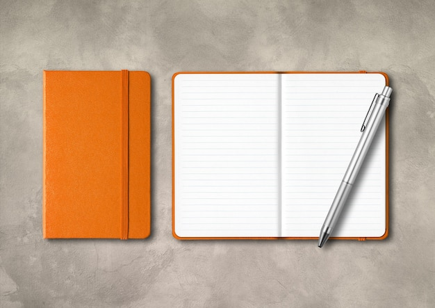 Orange closed and open lined notebooks with a pen