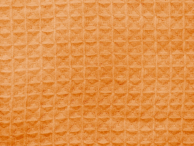 Orange cloth with seamless crocheted pattern