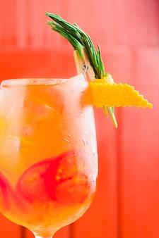 Orange cocktail with dried orange cork slice