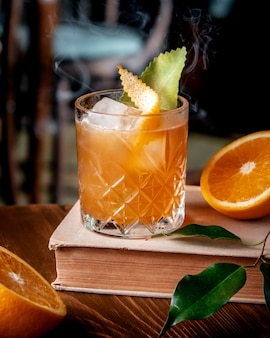 Orange cocktail with ice on the table