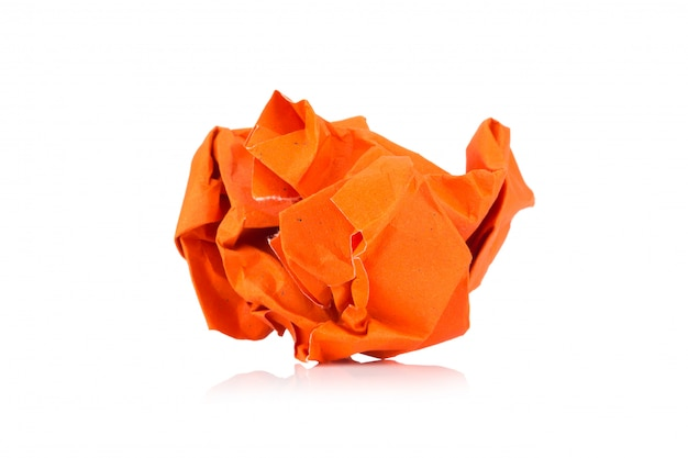 Orange colored paper ball isolated on white background