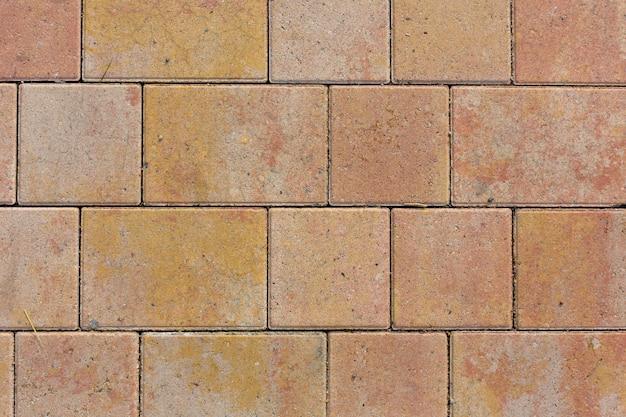 オレンジ色のコンクリートタイルテクスチャ背景