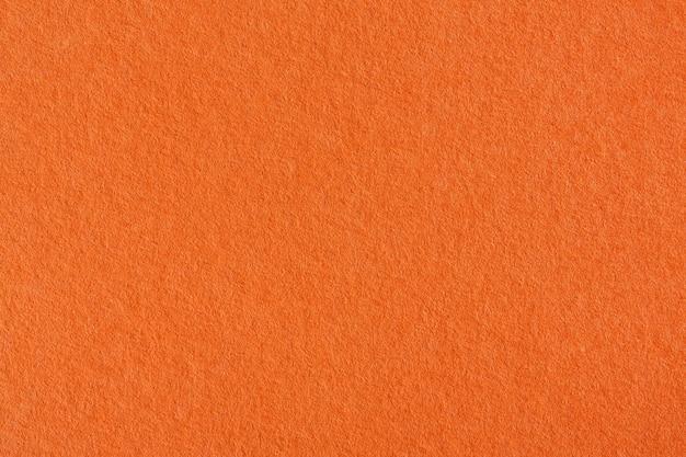 Orange crepe paper background texture. high resolution photo.