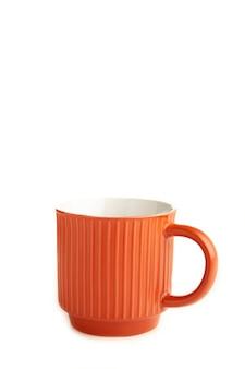 オレンジ色のカップは、白い背景で隔離。上面図
