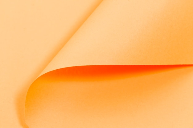 Orange curly pages texture with copy space