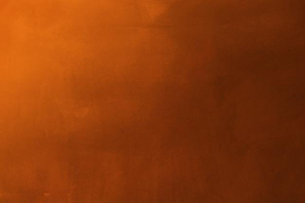 Orange and dark cement texture wall background