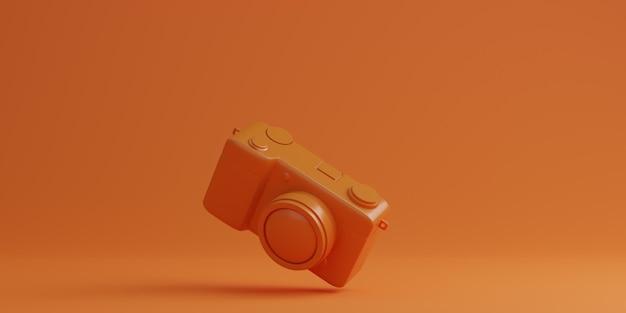 오렌지 배경, 기술 개념에 오렌지 디지털 카메라. 3d 렌더링