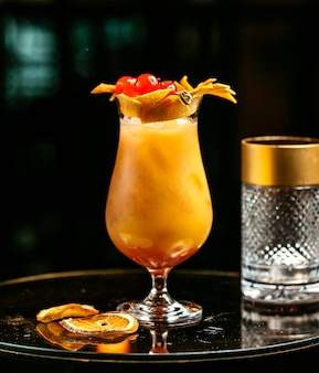 Orange drink garnished with orange peel