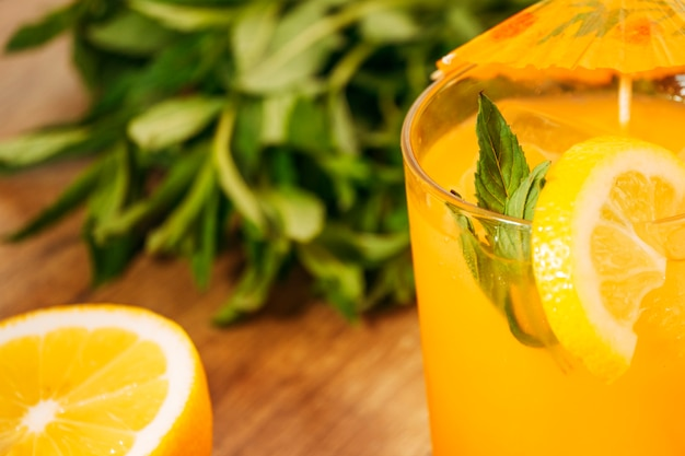 Orange drink with lemon slice