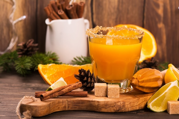 Orange drink with spices. christmas or new year background